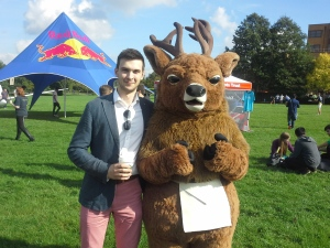 Uni Surrey mascot, Steve the Stag, dons an apron for a photo shoot.